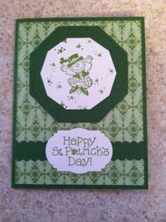 St. Patrick's day card using garden green card stock, gimbal green dsp, Stampin up rainbow's end stamp set and various dies.