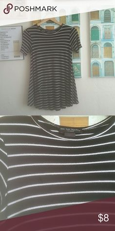 "Striped Shirt/ Tunic Black with white stripes  It has a ""swing"" silhouette, very comfortable and roomy Can be worn as a shirt or tunic, depending on your height Approximately 16 inches from armpit to armpit  Approximately 27 inches long  96% rayon, 4% spandex Tops"