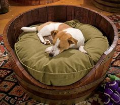 Wine Barrel Dog Bed. Cute idea and you can buy the wine barrels at Old Time Pottery in the Garden section!