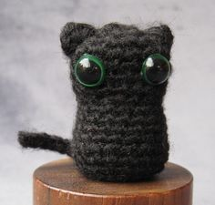 "Here's the pattern to make a tiny little cat - only 1.5"" tall - that's the perfect pet for my mini amigurumi Witch. Make in the traditional..."