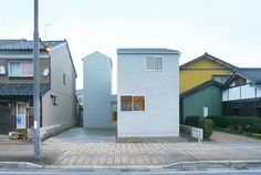 Completed in 2015 in Fukui , Japan. Images by HYAD architects. The architecture has a two-story part and and a three-story part attached to a one-story building. Its roofs and structure are shaped in the way that suits the general landscape of the district. The ground floor creates an L-shaped semi-public space with movable partitions. The second floor has two separate private spaces with a flat roof in between.