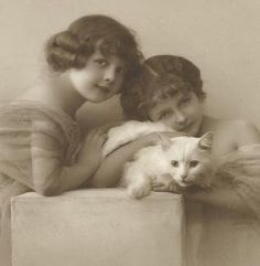 Beautiful girls with a white cat