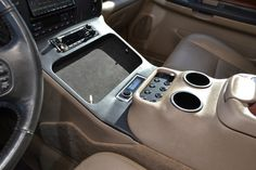 Custom center console subwoofer enclosure. Tray holds an iPad and phone.