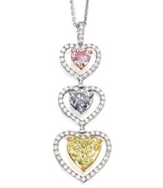 Pendant of platinum, 18k gold, 2.40ct fancy intense yellow diamond, .93ct fancy gray-blue diamond, .50ct fancy intense purplish pink diamond (estimated $90,000-120,000, Sotheby's New York, Feb. 6) - See more at: http://thejewelryloupe.com/hearts-on-the-block/#sthash.2cMvhmJJ.dpuf