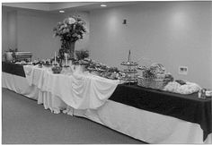 See if we can set up buffet table so that people to go down both sides of it. Check out this website for pictures of how they set up the tables (use crates for risers)