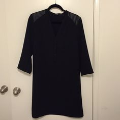 Black dress Cute black dress with (faux) leather detail on the shoulder.  Worn about twice.  Size Large.  Wear loose or cinch the waist with a belt for a whole different look! H&M Dresses Long Sleeve