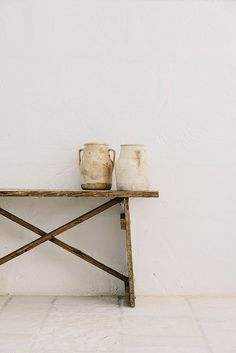 ceramic jugs on natural wood table at Masseria Moroseta. / sfgirlbybay