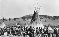Washakie & his warriors encamped in the Wind River Mountains, Wyoming,1870 Shoshoni Indians. Washakie ('shoots [the buffalo] running.). It is also said that the name means 'gambler's gourd.' A Shoshone chief, of mixed Shoshone and Umatilla blood. Before reaching maturity he left the Umatilla & joined his mother's people, the Shoshone. Washakie was noted chiefly for his friendship toward the whites & as a warrior against his tribal enemies.