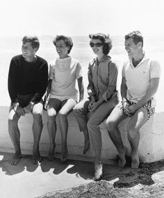 John F. Kennedy, Ethel Kennedy, Jackie Kennedy, and Robert Kennedy at the beach.