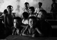 Vietnamese children in a schoolroom as a bitter civil war raged around them