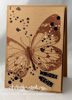 hand crafted card by Chrissie Stokes ... kraft ... one layer with faux stitched edge ... brown inked butterfly ... black splats and white pearls ...