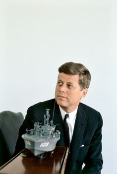 1961. JFK photographed by Elliott ERWITT with a replica of PT 109