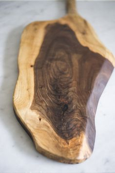 Add a warm touch of black walnut and serve your guests charcuterie, cheeses or any tasty delight on this beautiful board. This black walnut cutting board with a natural edge is a piece of art on its