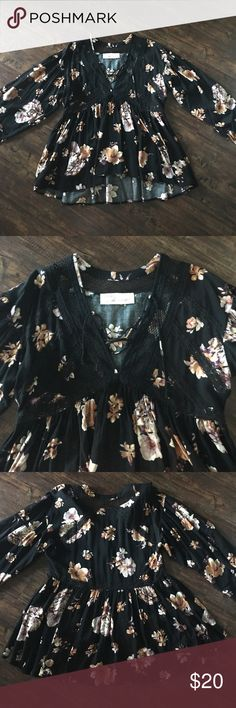 Flounce floral top Black floral top with lace detailing. Front tie with small bell sleeves. Sleeves have a button closer on the end Vintage Havana Tops Tees - Long Sleeve