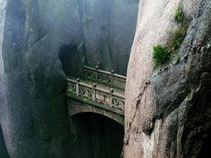 Stone Bridge between two cliffs, Huangshan of China. Photo by KM Cheng