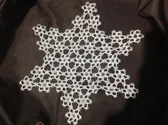 Tatted star doily