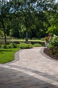 Mega-Kingston Pavers lend to a classic and distinguished look that's ideal for patios, driveways, walkways, and pools. See the Mega-Kingston Paver System. Front House Landscaping, Driveway Landscaping, Walkway, Legacy Collection, House Landscape, Bedroom Styles, Pavement, House Front, Outdoor Entertaining
