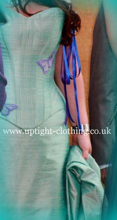 Emma had an original design based on the Aqua Aura Design. Consisting of a hourglass corset in Aqua silk with purple embroidered butterflies and sparkling Swarovski crystal trails. The corset has removable hanging sleeves attached by purple and blue ribbons. The Skirt was full length fitted style skirt in Aqua silk, with fish tale train, with elephant embroidery, to the same design as Emmas wedding invitations and running theme. Turquoise Wedding Dresses, Embroidered Butterflies, W Dresses, Gorgeous Fabrics, Blue Ribbon, Looking Stunning, Hourglass, Corsets, Skirt Fashion