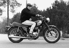 Steve McQueen astride a Triumph Bonneville.