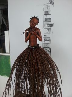 Title : Girl with Bird - Kasi Skirt Range by Audrey Rudnick. Mixed media Urethane, acrylic and fruit strands from a palm tree Palm Tree Fruit, Palm Trees, Palm Fronds, Art Dolls, Sculpture, Wind Chimes, Statues, Mixed Media, Bronze