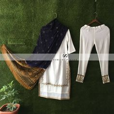Bandhani silk dupatta paired with sophasticated white suit adorned with intricate hand work. Perfect as an occasion wear for the weddings . Visit our Flagship Store at For further details DM us or Whatsapp us on 91 95371 65033 . Indian Attire, Indian Wear, Indian Outfits, Ethnic Trends, Kurta Patterns, Outing Outfit, Indian Designer Suits, Indian Look, White Suits
