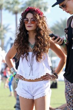 Vanessa Hudgens interprets the Coachella style formula as simply as possible. Peasant tops + flower crown + circle-frame sunglasses