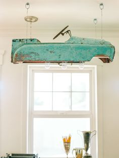 Vintage metal pedal car upcycled into a cool hanging light fixture.