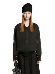 Autumn/Winter 2014/2015. Neoprene Jacket. Jacket: 100% Polyester. Padding: 100% Polyester. Rib knit: 100% Wool. Arm detail: 100% Polyurethane.  $737.90  Photo from DKNY.