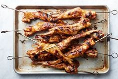 Chicken Wings on Skewers / Photo by Chelsea Kyle, Food Styling by Kat Boytsova http://www.epicurious.com/expert-advice/the-trick-to-great-grilled-chicken-wings-tips-recipe-article