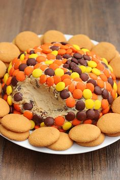 Here is a cheese ball that's on the sweet side to serve with fruit or cookies. Cream cheese, peanut butter and Reese's candies are a perfect combo!
