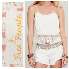 Free People top Free People White Sands cotton crop top, size small.  So cute!  Off white ivory color, cropped, crocheted hem, string tie back with beaded ends, unfinished hem on a top ruffle, elastic back for a great fit!  NWOT.  model pics from FP website & Lyst. Free People Tops Crop Tops