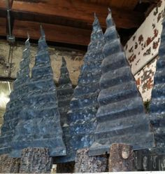 I am not ready to cut and paint again but love these painted in country white. Rustic Christmas Trees...made from corrugated metal & tree branch pieces.
