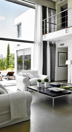 Polished concrete floor, high ceiling,  glass wall, and the great colour scheme of black and white..  just amazing..