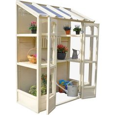 The Hartwood Victorian Tall Wall Greenhouse is flexible and compact. The Greenhouse includes two heights of shelving and the middle shelves can be adjusted to accommodate any taller plants. The greenhouse has two opening vents suitable for use with aut Victorian Greenhouses, Wooden Greenhouses, Lean To Greenhouse, Greenhouse Plans, Homemade Greenhouse, Greenhouse Gardening, Diy Mini Greenhouse, Miniature Greenhouse, Outdoor Greenhouse