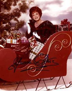 Maureen O'Hara looking gloriously beautiful and Holiday-ish in Santa's Sleigh!