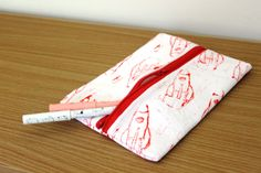 Hand-printed hand-sewn red rocket pouch by Yoliprints on Etsy
