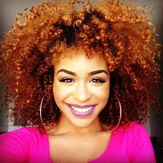 Her ombre effect hair color highlights her natural curls beautifully!