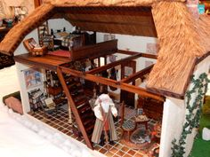 Interior of the Wizard's Cottage showing the sleeping loft (and the wizard, dressed by my mom)
