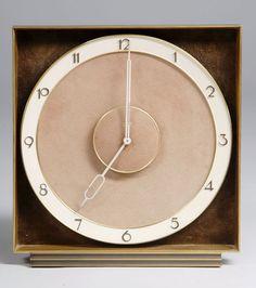 An Art Deco mantel clock by Kienzle  Solid brass, suede, brass numbers  Germany, c.1928-30