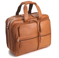 Leather Dual Laptop Bag - This Leather Dual Laptop Bag is a fine quality business travel bag and dual laptop bag. It is very versatile and has a very modern elegant look. This bag has many features like four zipped pockets on the front for small items and a large zipped central compartment that has two further compartments one of which is for a laptop sleeve. It comes with a matching and adjustable leather strap and comes in Black, Brown and Tan colour.