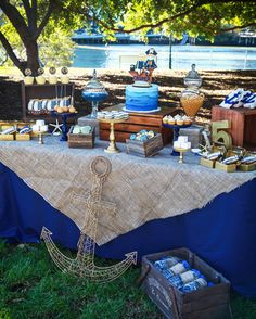 Pirate Dessert Table... I like the wooden boxes for risers & the burlap over the tablecloth.