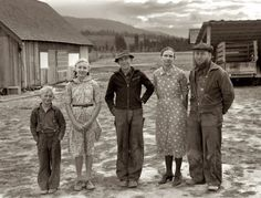 October 1939. The Unruf family. Mennonite wheat farmers from Kansas, now developing a stump ranch in Boundary County, Idaho. The mother, father and 15-year-old son with other children. Father and son have cleared 30 acres of raw stump land in three years.  by Dorothea Lange for the FSA.