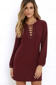 The lace-up trend just keeps getting better, as proven by the Up, Up and Away Burgundy Lace-Up Dress! Medium-weight woven poly fabric shapes a lace-up front with gunmetal grommets amid a darted bodice. Long sleeves with tapered button cuffs fall alongside the sheath silhouette. #CuteDresses #TrendyTops, #FashionShoes #JuniorsClothing