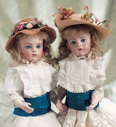 """Gorgeous pair of size 3 French bisque bebe Bru twins. Having an outstanding presence,splendid eyes,original sturdy bodies, bisque hands,antique costumes,original signed Bru Jne shoes,and well-detailed family provenance. They were presented in Theriault's 2004 auction, """"Bon-Bons For The Bonnet Ladies of Tiffin"""" in Newport Beach, CA."""