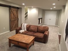 Finished basement. Walls are Agreeable Gray by Sherwin Williams.
