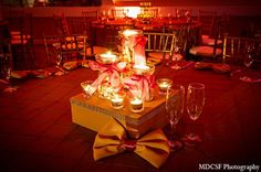 indian wedding reception decor gold table setting candles http://maharaniweddings.com/gallery/photo/12138