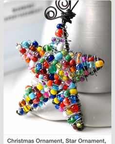 marbles in a wire star christmas tree topper