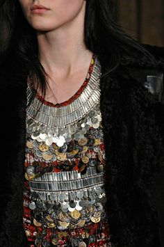 """I once had a necklace I called my """"hippie pennies."""" This reminds me of it. This shirt is tribal, kinetic and glorious."""