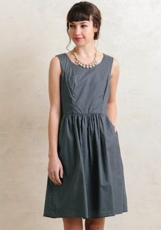 Classic and preppy, this darling knee-length dress features a fit-and-flare silhouette and an allover polka dot print in hues of blue and cream. Complete with pockets at the side and a hidde...