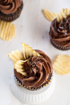 """An incredible chocolate """"chip"""" cupcake with coffee glaze, chocolate ganache, right chocolate buttercream, caramel drizzle, fleur de sel and potato chips. Heaven in a cupcake."""